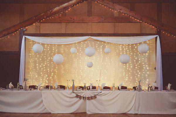 Wedding reception lighting idea - Chinese paper lanterns and hanging string lights  {Elisavet Photography}