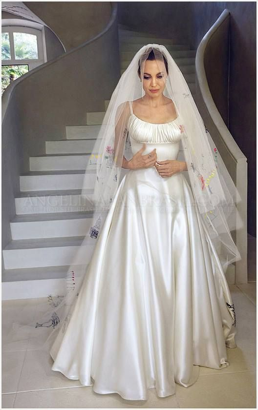 Angelina Jolie in her custom wedding gown by Versace with all her children's artwork scattered throughout the dress. Married Brad Pitt on Aug. 23, 2014