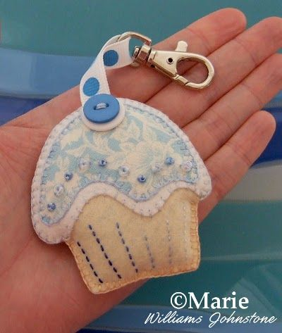 Blue white and cream cup cake plush keychain with bead and button detail
