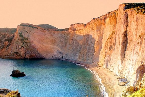 Located on Ponza, the largest island in the Pontine archipelago, Chiaia di Luna is a geographic gem—a narrow arc of sand beneath a towering volcanic wall shaped like a crescent moon.