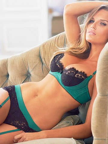 Teal and navy blue lingerie. Bra, panties and garter straps.