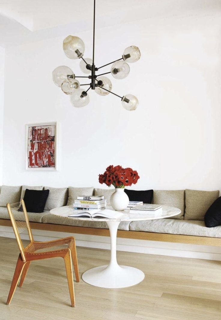 built-in sofa platform in the dining area, Saarinen marble-topped table