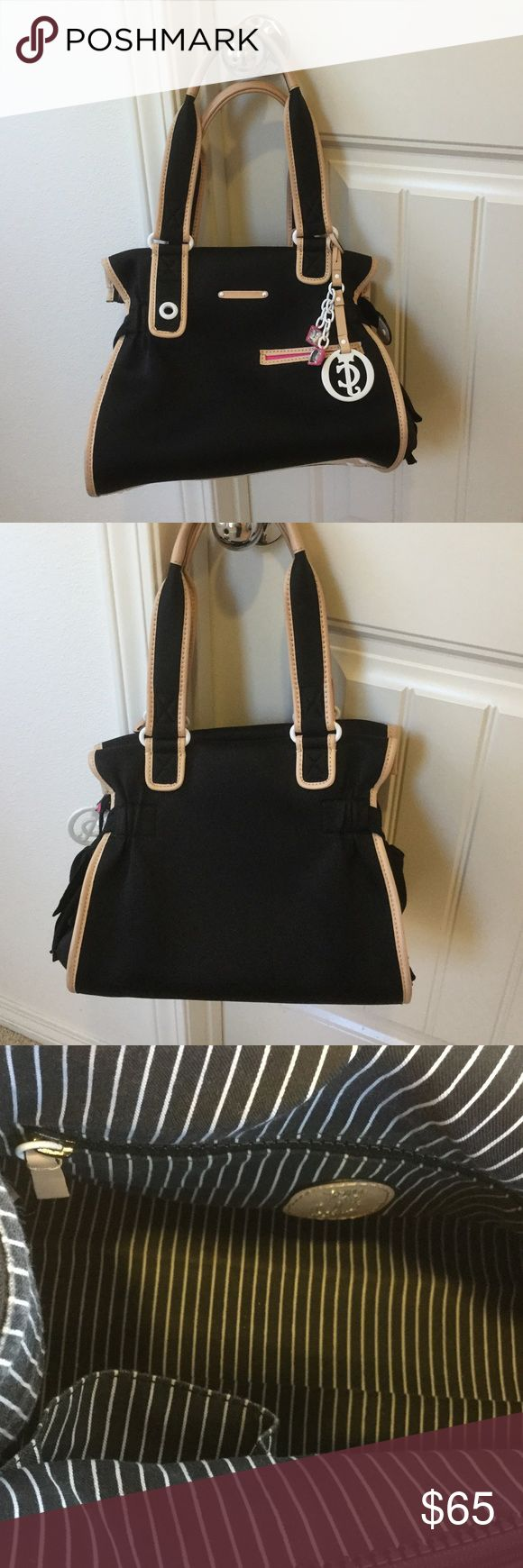 """Juicy Couture nylon handbag Black nylon Juicy Couture handbag. One exterior pocket hidden by a grograin ribbon on each side with one pocket on front panel. One zippered pocket with two open pockets on the interior. H: 11.5"""". L: 13"""". W: 9"""". Miniscule imperfections shown. Juicy Couture Bags Satchels"""