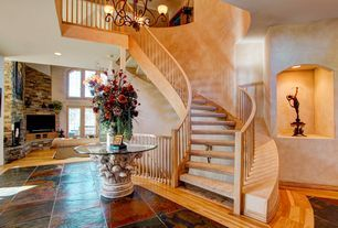 Contemporary Staircase with High ceiling, Chandelier, Hardwood floors