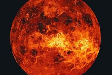 Venus' atmosphere traps heat from the Sun as an extreme version of the greenhouse effect that warms Earth. The temperature on Venus are hot enough to melt lead.