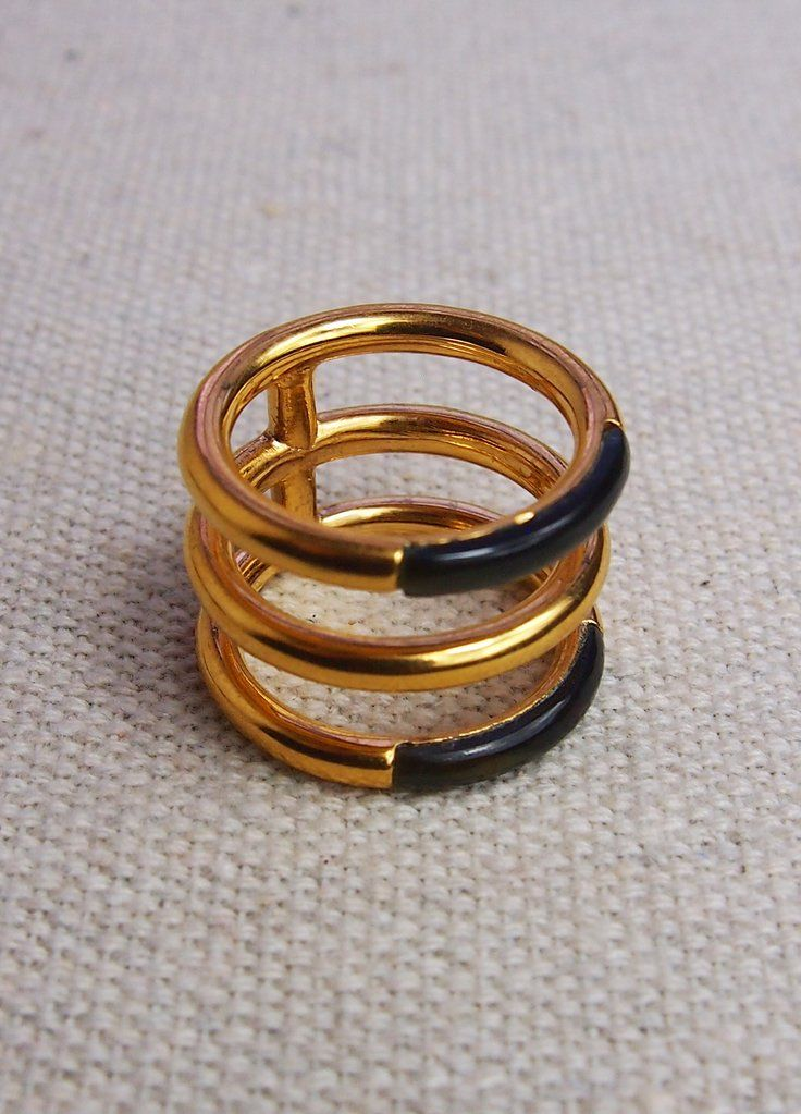 Three band ring with blue tiger's eye inlay.