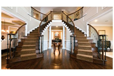 A pair of elegant sweeping staircases define the stunning for Dual staircase house plans