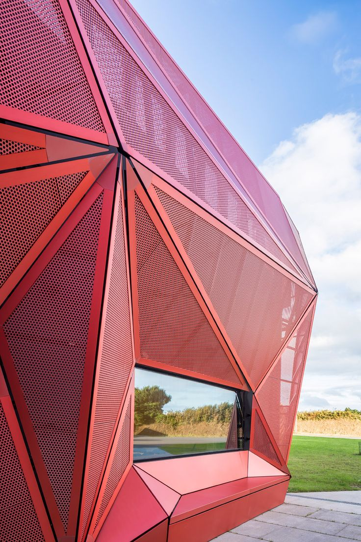 Faceted red metal creates sculptural facade for music centre by Peripheriques