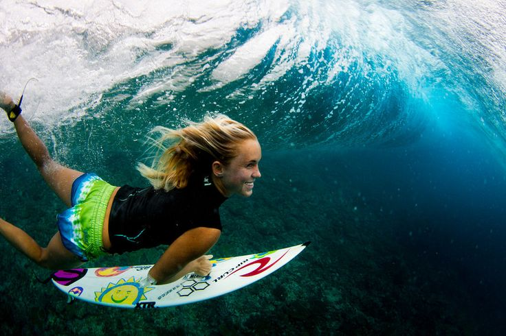 Bethany Hamilton stills surfs with a smile, despite losing one arm to a tiger shark. <---- You go girl!!
