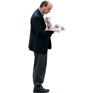 Business Man Reading Newspaper | Immediate Entourage