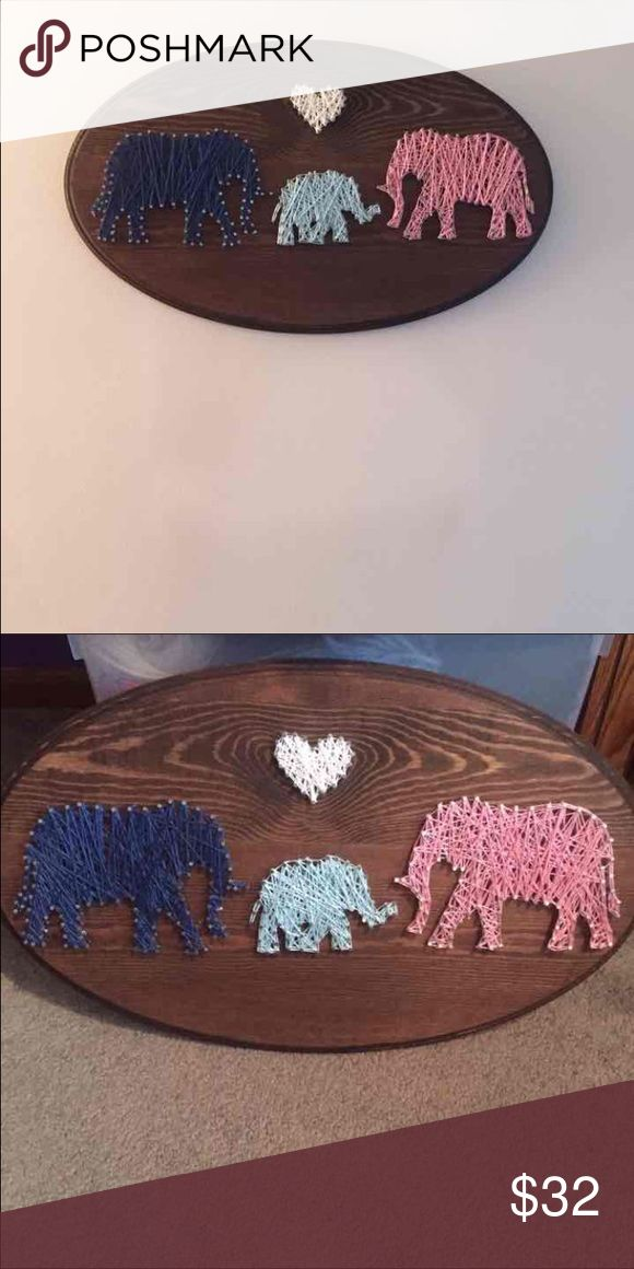 "Elephant family string art Handmade. Two parents with baby elephant. Perfect for a nursery. Dark stained wood. Can custom if you'd like. 20""x9"" Other"