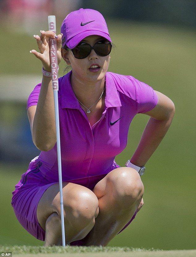 Michelle Wie, favorite US Open golf contender stuns in her racy slinky purple dress.