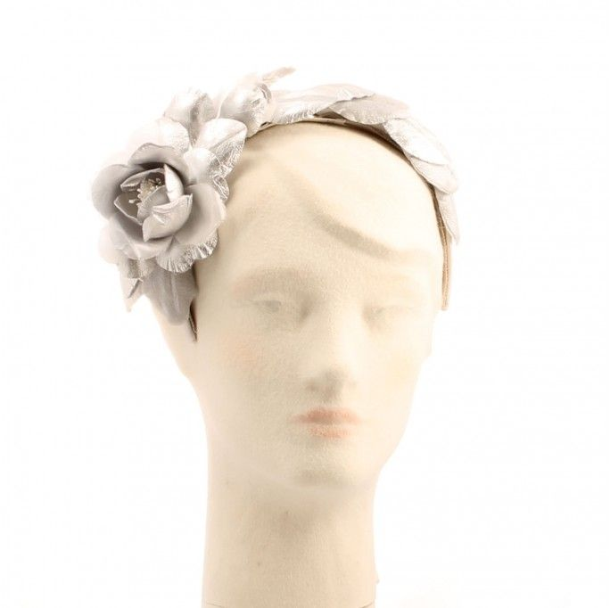Metallic leather Grecian style headband. Silver leather petals on headband   Label: Gabriela Ligenza   This hat is made by hand in Italy and finished in the United Kingdom