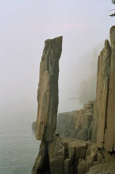 The balancing rock trail on Nova Scotia Long Island. For thousands of years this balancing rock has stood teetering on the edge of the ocean, providing quite a sight for all visitors to the trail....