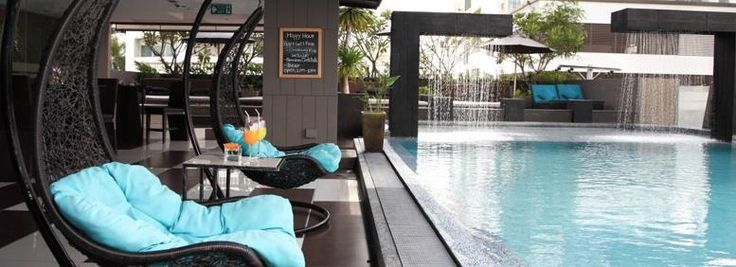 Swimming pool in Golden Tulip Mandison Suites: after a swim, grab a drink from the bar and relax watching Bangkok's skyline.