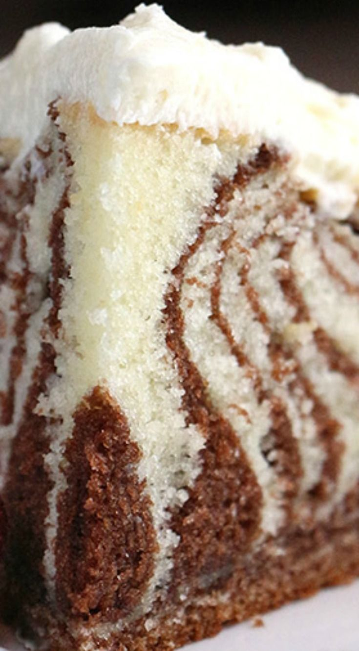 Zebra Cake with White Chocolate Buttercream ~ The perfect blend of half dark chocolate and half vanilla batter poured into a presentation that will wow... Any simple cake batter can become a zebra cake, it's all in the method you use to pour it into the pan