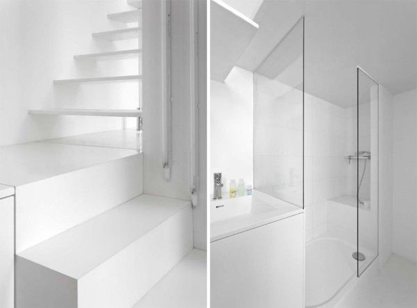 The bathroom sits just on the other side of the kitchen beneath the loft and under the stairs