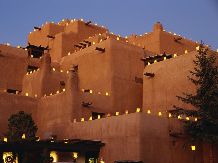 Inn at Loretto, Santa Fe at #Christmas. #Luminarias or #farolitos, a Christmas tradition in New Mexico. The bags are partially filled with sand, add a candle and light the way the baby Jesus.