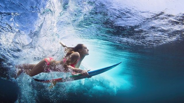 Surfer girl diving under a wave - Awesome underwater shot. #kilroy #surfing #surfer #waves #ocean