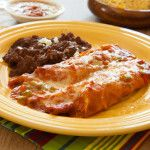 Simply delicious! Ooey gooey enchiladas with shredded chicken and homemade red sauce then topped with cheese and more sauce! what's not to love?