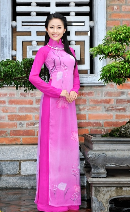 "Vietnam's national dress, the ao dai (literally ""long shirt""; pronounced ""ow zai"" in the north, ""ow yai"" in the south) consists of two elements: a long tunic with a close-fitting bodice, mandarin collar, raglan sleeves, and side slits that create front and back panels from the waist down; and wide-legged pants, often cut on the bias. While in the past both men and women wore ao dai, in the twenty-first century it is almost exclusively a women's garment."