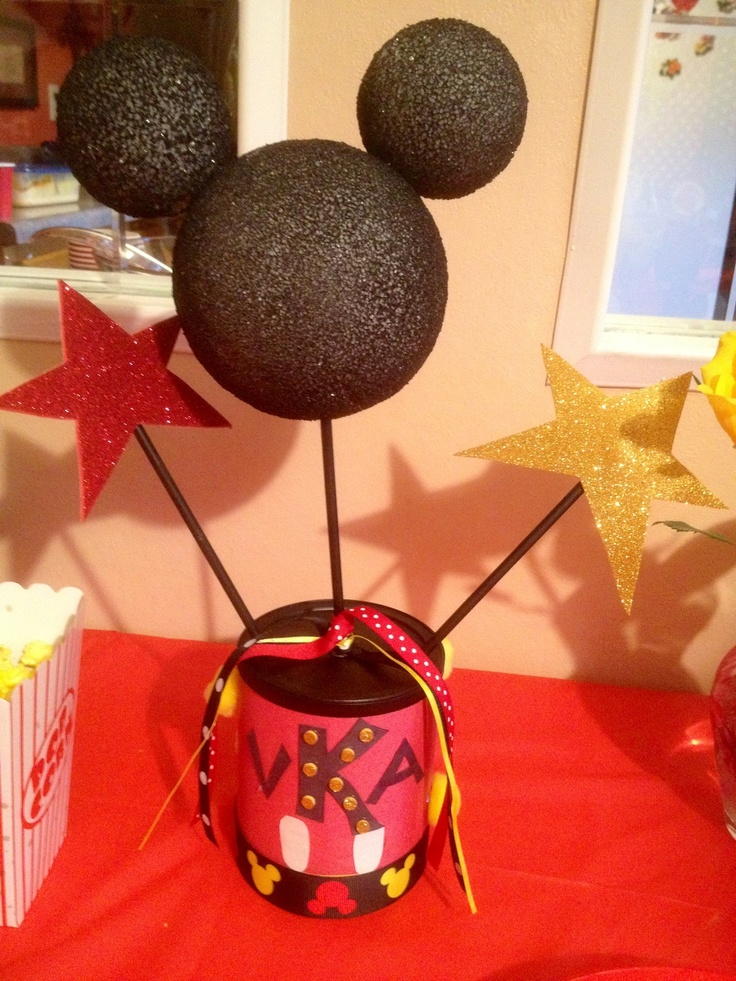The centerpieces. Made from formula cans that were spray painted and wrapped in construction paper. Also used glittered foam for the stars.