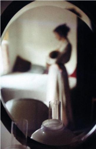 Saul Leiter - Mother And Baby In Mirror, 1950s