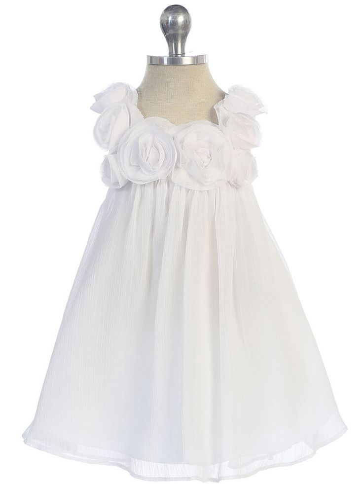 Perfect for tiny twirlers this frock flaunts generous size Rosettes along the neckline with an A-line shape. Made from Chiffon and fully lined with underneath netting, this style is soft, has nice mov