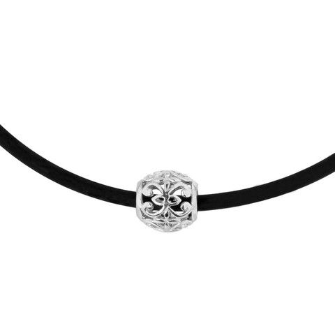 Lace bead 2 pendant | ANTIKA A sterling silver slider pendant with a cut-out pattern. The pendant is threaded on a neoprene choker with a sterling silver clasp.