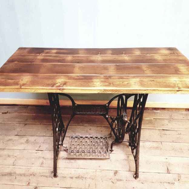 Cider Mill Board Table Top with Singer Sewing Table Base   Bespoke table made using 1850's cider mill board planks for the top, finished with a dark stain and clear wax, with a singer sewing machine table legs.