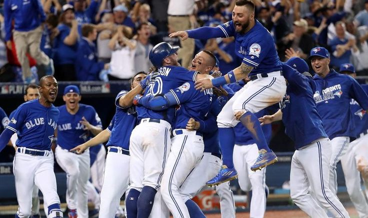 The Blue Jays celebrate as they head to the ALCS for the second straight year--Tom Szczerbowski/Getty Images