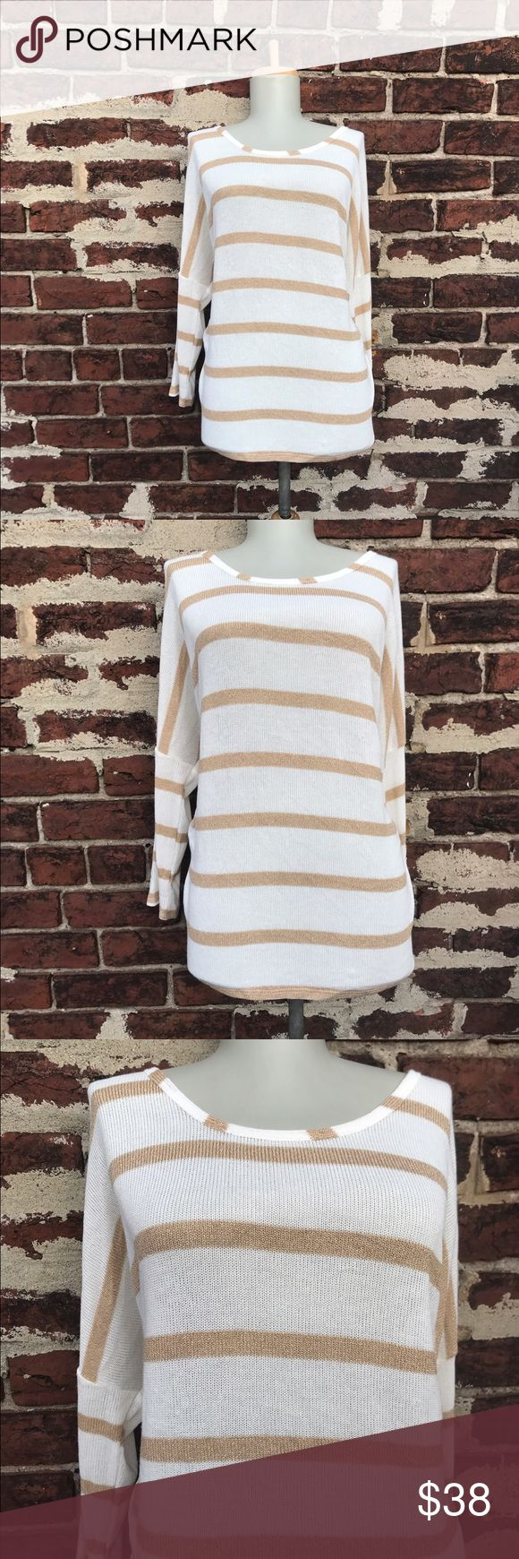NWT Papermoon XL Stitch Fix Jamie Knit Sweater Top You're looking at a beautiful knit top / sweater by Papermoon (for Stitch Fix)! Ivory with metallic gold striped throughout. Slouchy dolman sleeves.  Size XL    Polyester / Rayon / Metallic / Spandex Made in USA   New with tags Papermoon Tops