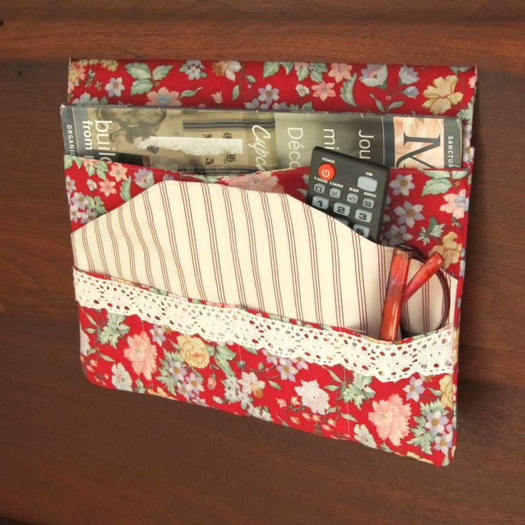 Red Bed Pocket Bedside Caddy is Fun and funky!Made out of vintage Cranston Prints fabric, and holds your remotes, or other things you may need at your bedside.