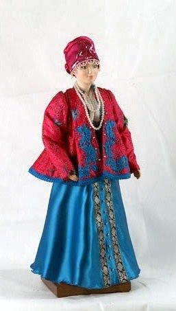 A doll in the Russian traditional costume from Vologda Province on the fashion of the 19-th century.