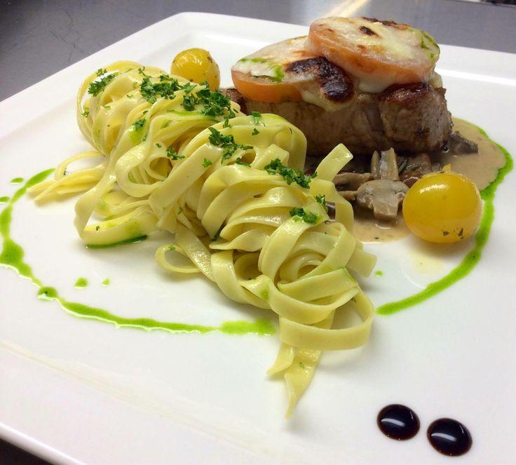 Gratinated pork steak with noodles and mushroom sauce #restauranttaverne #hotelinterlaken
