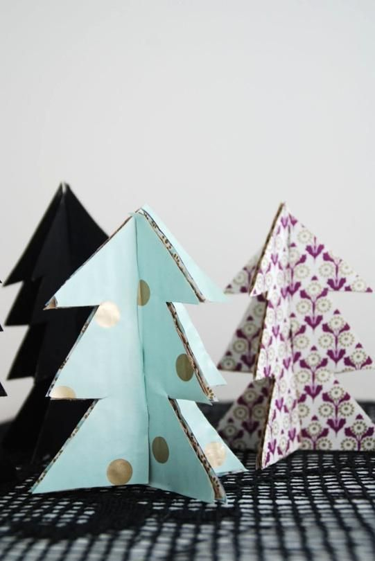 Christmas trees made from painted cardboard cutouts.