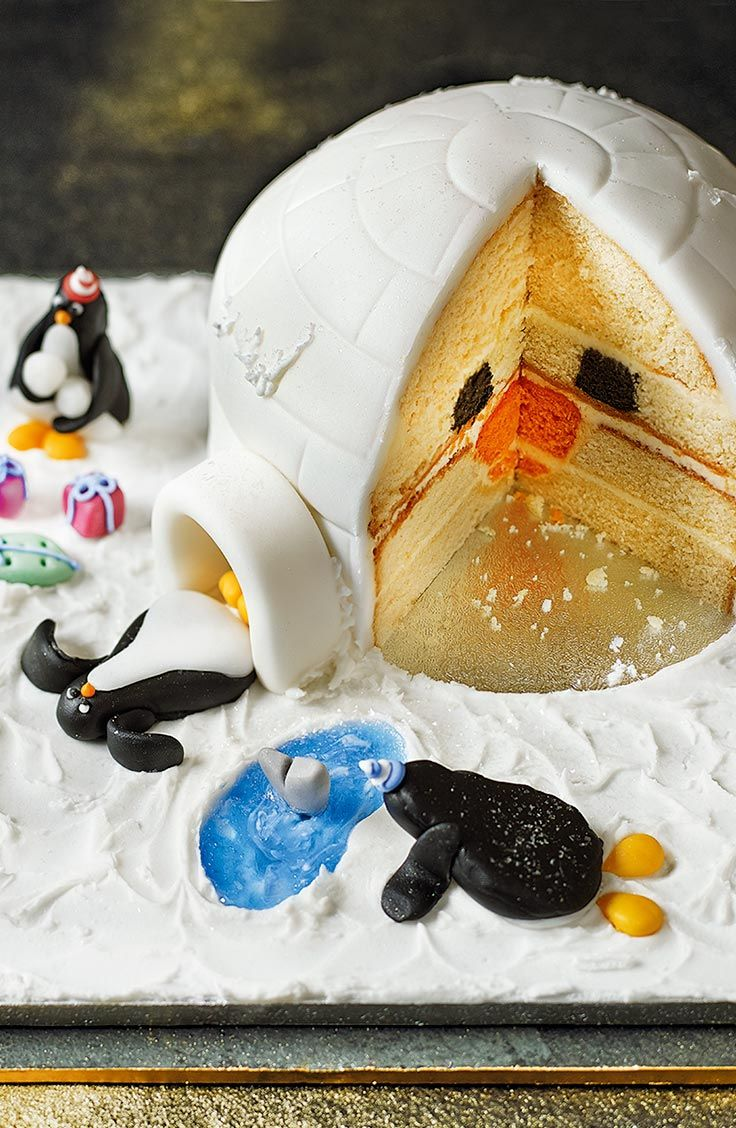 Our Penguin Party Cake will delight kids (and grown-ups) this Christmas when the hidden penguin face is revealed.