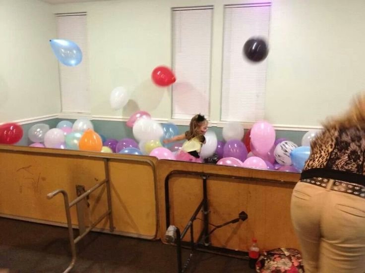 Awesome idea for a kids party. Create a balloon pit by blocking an area of the room off.