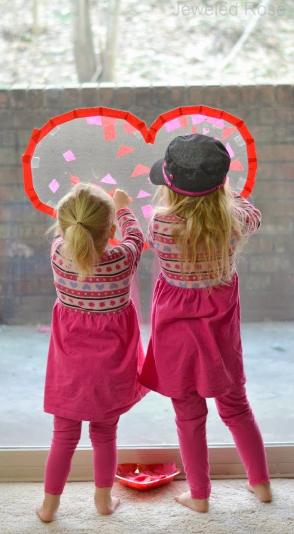 Sticky heart suncatchers are fun for kids to make and look beautiful hanging in the window- a perfect craft for Valentine's Day!
