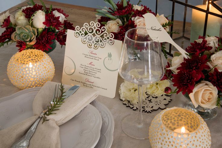 Ivory menu with swirl cutout detail. Bird glass topper. Mint and marsala colour scheme. Styling by Jani Venter. Photo by Rikki Hibbert. Flowers by Diamonds & Pearls Event Styling.