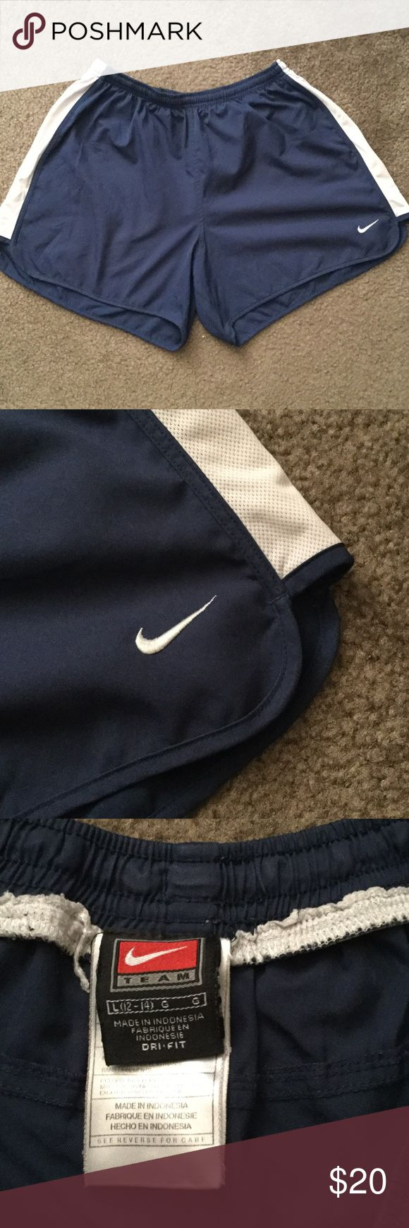 Nike soccer shorts Navy blue and white. In good condition, however I cut the lining out due to it being very uncomfortable playing soccer with the lining in. Lots of life left in these! Nike Shorts