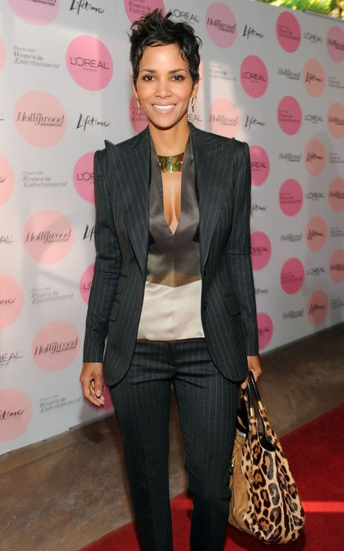 Gorgeous suit...Halle Berry. Loving the blouse and animal print purse too!