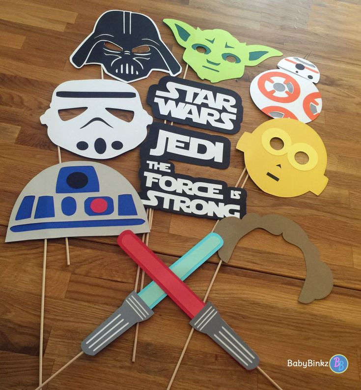 Embrace your inner Jedi and strike a pose with our Star Wars Inspired Photo Prop Set!  Planning a photo booth at your next event or want to add Star Wars-flair to your family photos? Our photo props make capturing memories fun & hilarious for everyone! All photo props are made with layers of premium smooth cardstock and securely mounted on a 12 wooden dowel. They are delivered fully assembled and ready for posing! Our Photo Props also make great additions to any centerpiece!  This 12 piece…