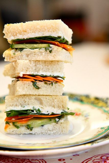 Green goddess tea sandwiches: In a bowl stir together softened cream cheese with about 1/4 cup of fresh chives black pepper  a bit of lemon zest Thinly sliced cucumbers, carrots (shaved with a vegetable peeler)  spinach Cream cheese chive spread spread on one side of crustless white bread Fresh basil mixed with butter slathered on the other side of crustless white bread