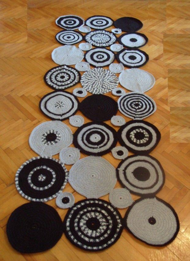 Crochet carpet. Gray and black