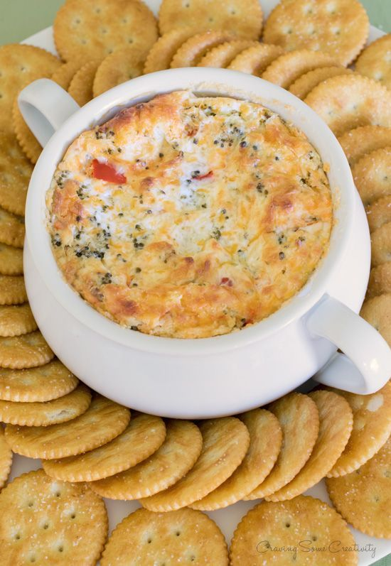 Warm Broccoli Cheese Dip Recipe - Cheddar and Parmesan make for a wonderfully hot and cheesy broccoli dip that is sure to be a crowd pleaser. People will be begging you for the recipe!