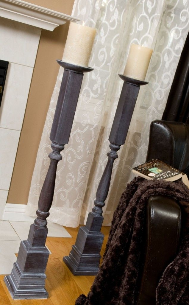 DIY standing candle pillars... using staircase spindles, baseboard trim, a small metal or wooden plate/dish, and paint!