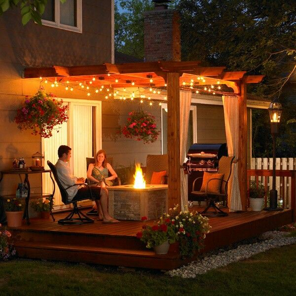 Pergola, fire pit, deck, string lights. Love love love.