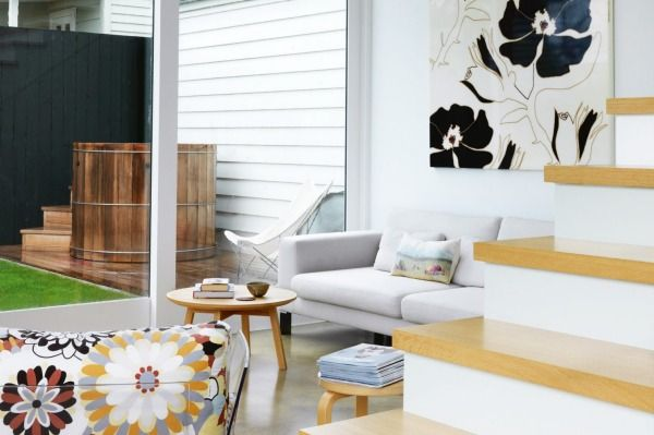"""A Marimekko print hangs in the sitting room; the couch has been recovered """"a million times,"""" says Sarah; the coffee table is by Douglas and Bec."""