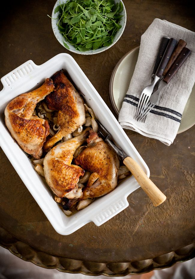 Chicken with 40 Cloves of Garlic by yummysupper. Recipe by Alice Waters: This easy chicken dish, from Alice Waters' fantastic new cookbook Art of Simple Food II, is just the kind of comforting one-pot main that calls my name this time of year. The chicken is tender, moist and infused with a subtle herby garlic flavor - plus all those roasted garlic cloves are heavenly squeezed onto little toasts. #Chicken #Garlic #Alice #Waters
